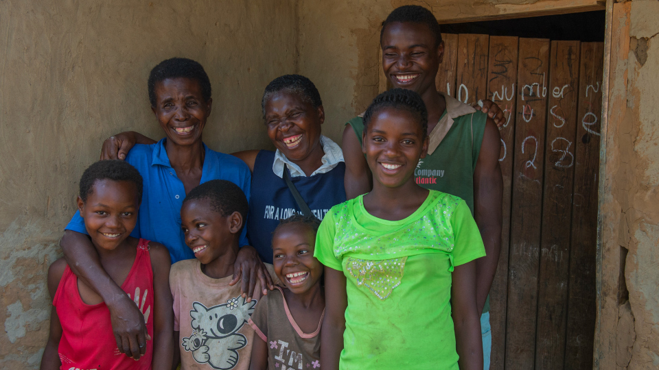 Edina Napungwe, Florence Mukoboto, CMMB community health worker in Zambia, with Alfred and his siblings.