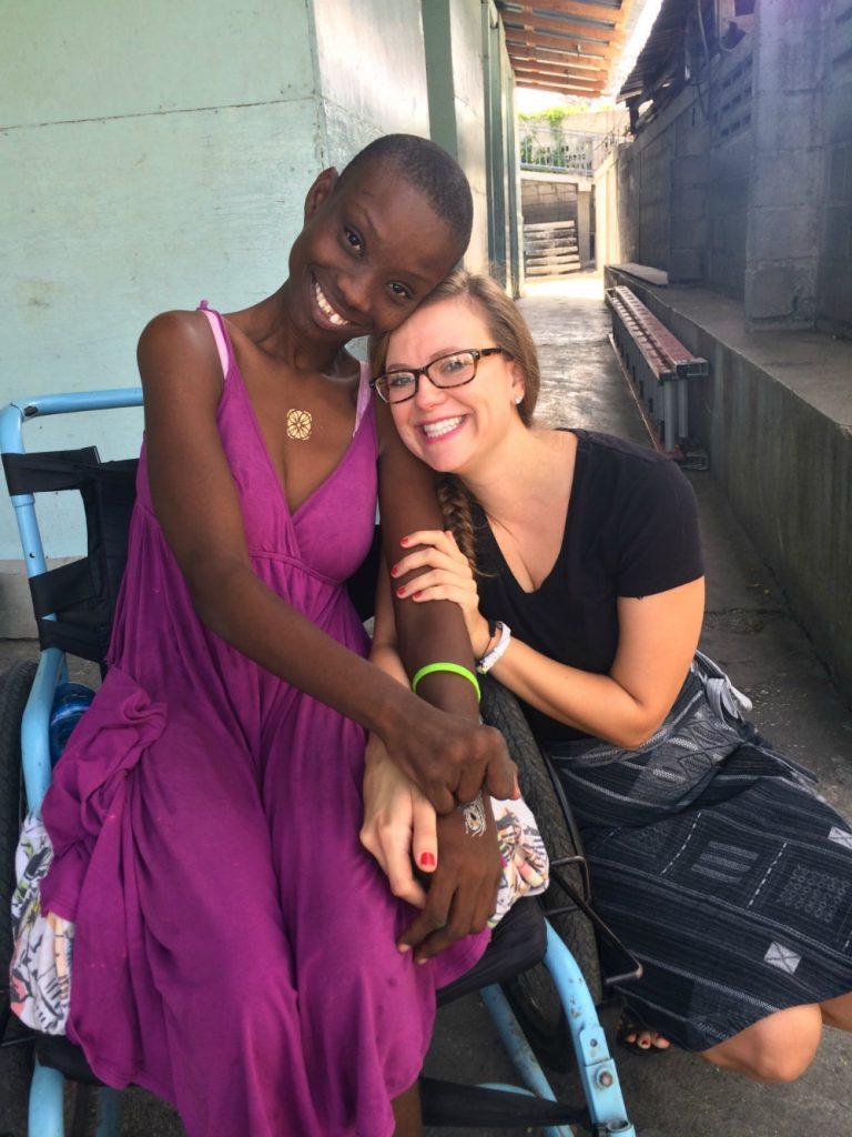 Volunteer pharmacist Brittany in Haiti embraces her Haitian friend.