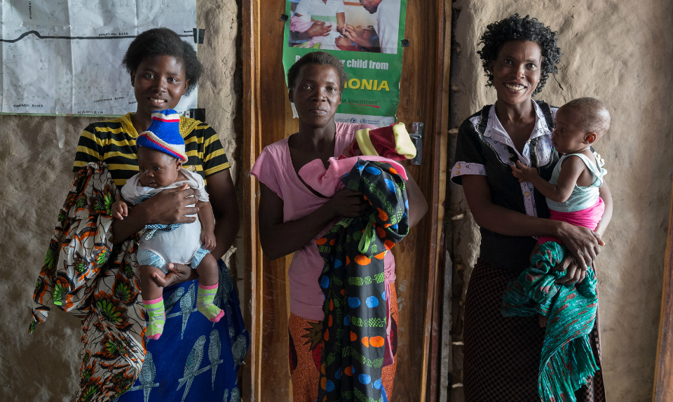 mothers and children receive support from community health workers