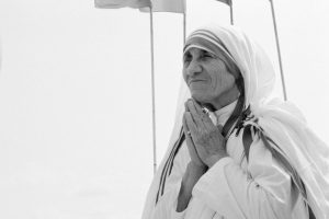 St. Paul, Canada - June 25, 1982: Mother Teresa visited St. Paul, Alberta, to receive a gift from the community — a small house, which she sold to build a leper colony in India. On the podium, after receiving the $925,000 cheque she shows her gratitude for this generous gift.