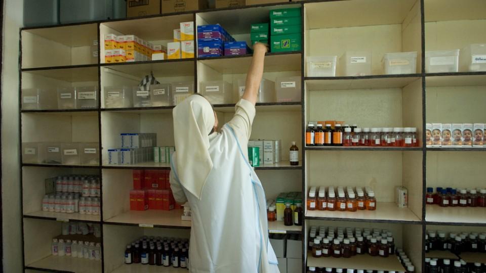 nurse stocking a pharmacy in Haiti