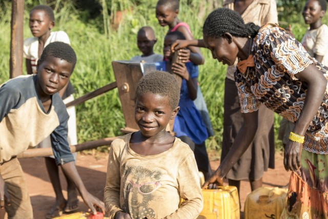 Women and children getting water in South Sudan