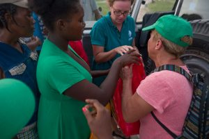 people impacted by hurricane matthew receive supplies