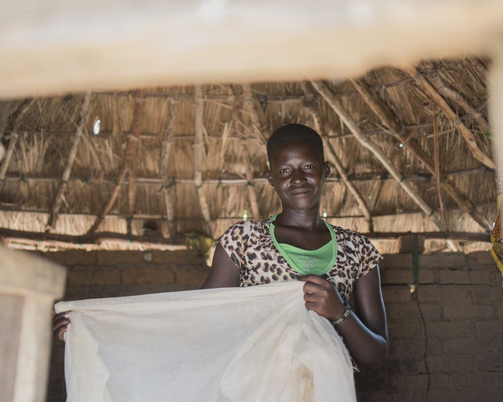young woman with mosquito net in south sudan