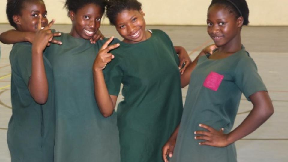 Zambian girls standing together international girl child day