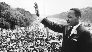 Martin Luther King addressing a large crowd tolerance