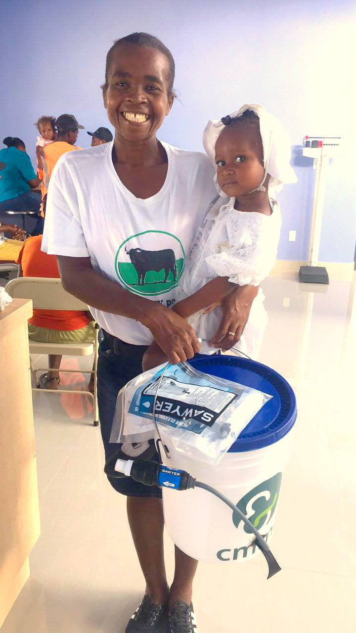 Imacula and her daughter Ishlove received their water filter during a recent visit to theBishop Joseph M. Sullivan Center for health in Côtes-de-Fer