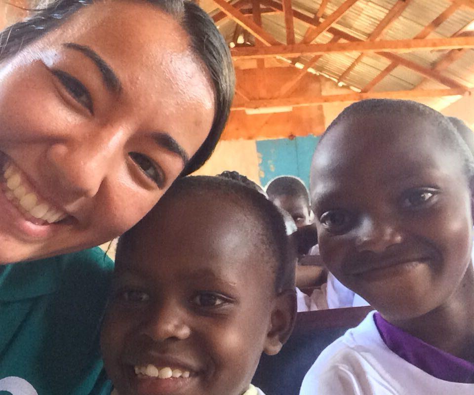 Volunteer Anne with children during world aids event in Kenya