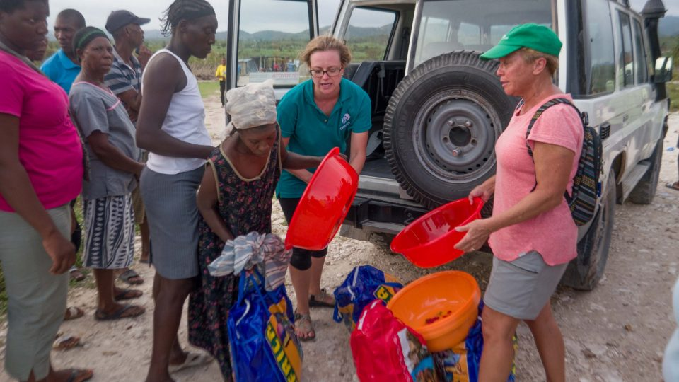 Brittany Jonap and fellow volunteer Robin Maddox give out emergency relief kits to impacted community members hurricane matthew