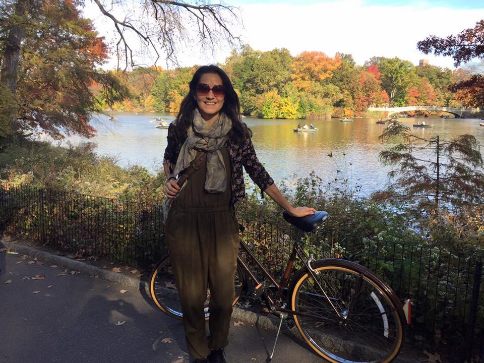 Marcia Ortega on a bike in New York CMMB coordinator of international volunteer program