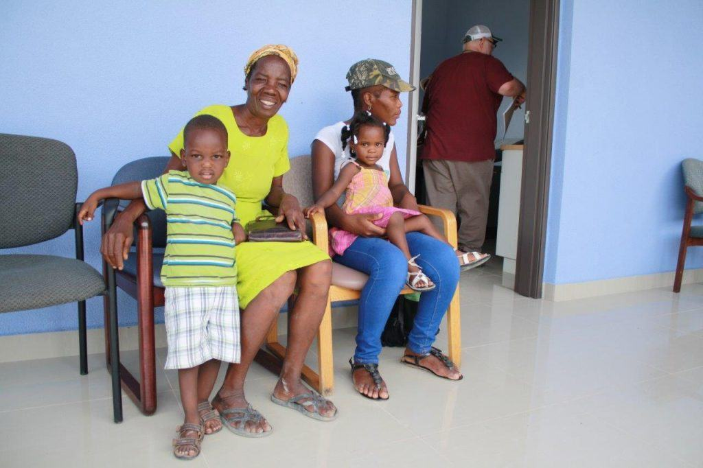 Several visitors wait to be seen with their children. at a new hospital in Haiti.