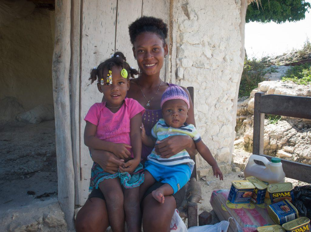 Mylove and Kerby with their mom, Cleyese at their home near Cotes-de-fer, Haiti.