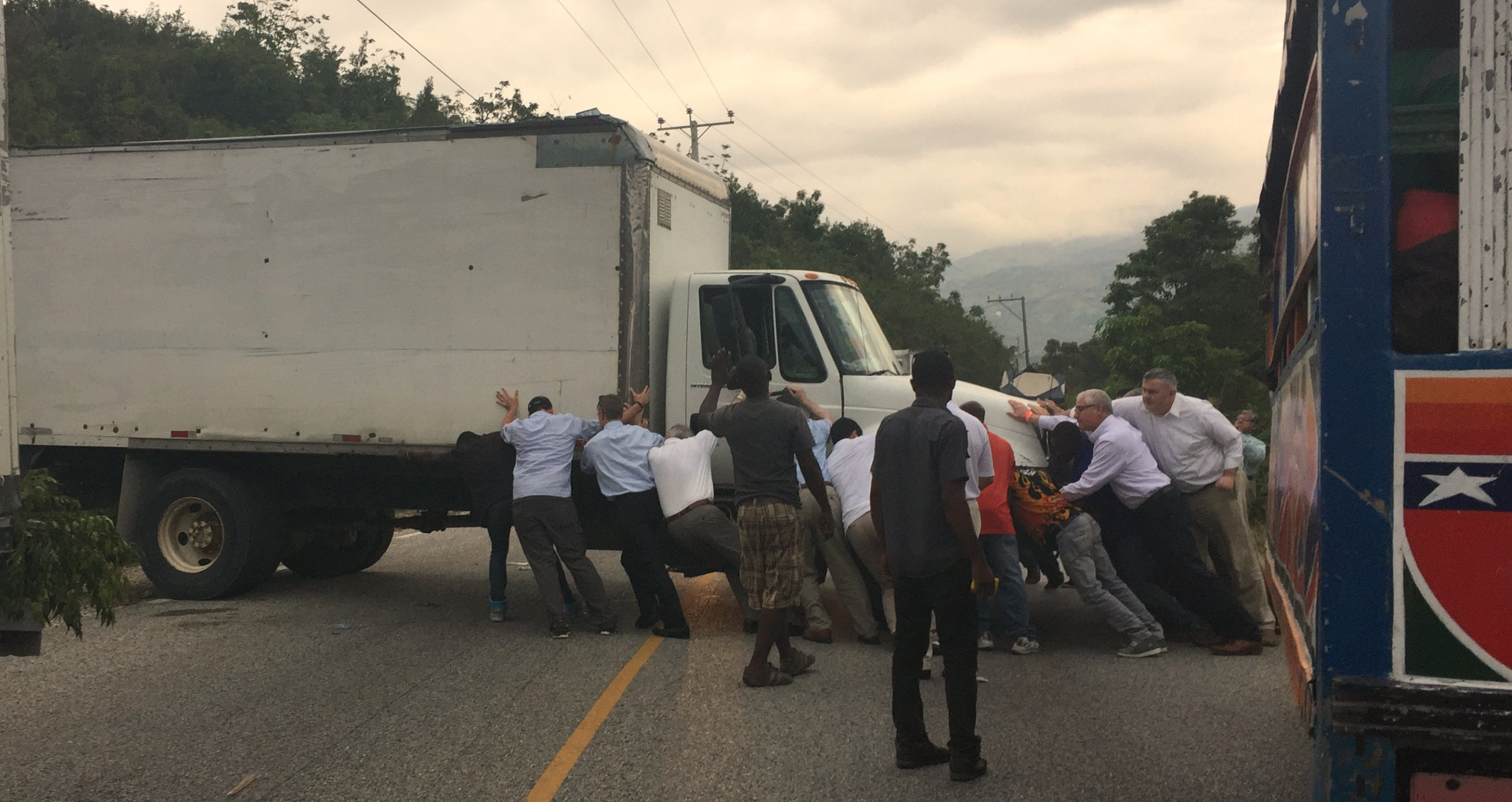 Everyone who travelled to Haiti for the dedication leaned into to give this truck a push