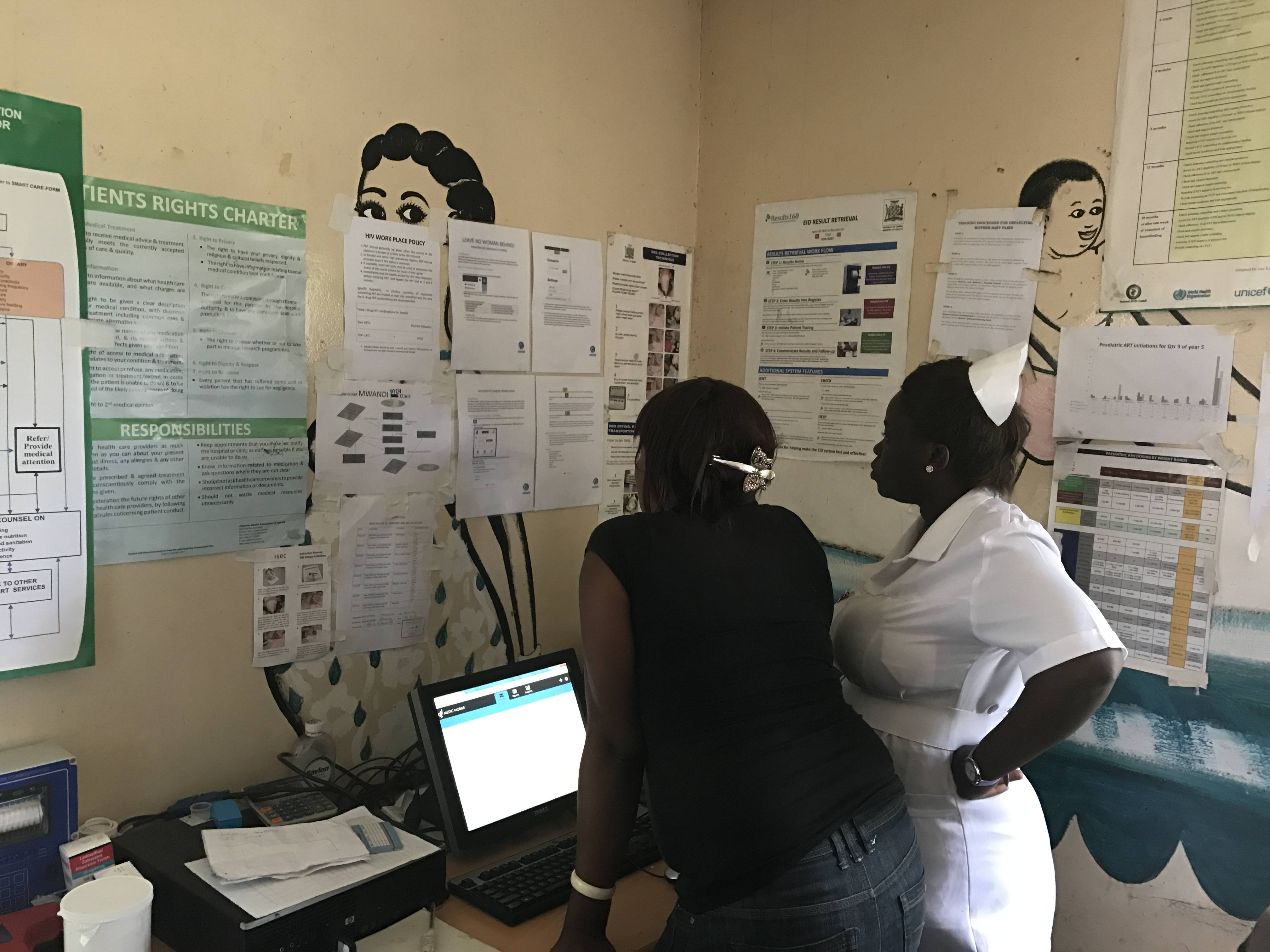 Facility workers going through system instructions in ZAMBIA