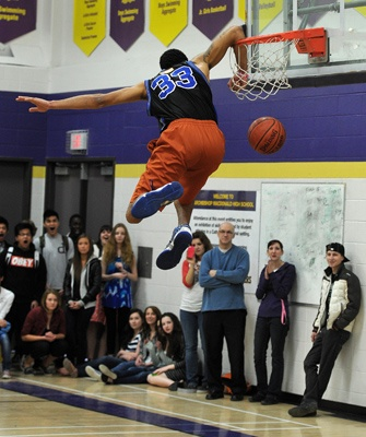 EDMONTON, ALBERTA, APRIL 20, 2012: NAIT Ooks player Clayton Crellin takes part in a slam dunk contest to raise funds for the Edmonton Humane Society at Archbishop MacDonald High school in Edmonton, Ab on Friday, Apr. 20, 2012. ( Photo by John Lucas/Edmonton Journal)