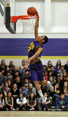 EDMONTON, ALBERTA, APRIL 20, 2012: 15 year old grade 10 student Deonte Ooslou-Oochos takes part in a slam dunk contest to raise funds for the Edmonton Humane Society at Archbishop MacDonald High school in Edmonton, Ab on Friday, Apr. 20, 2012. ( Photo by John Lucas/Edmonton Journal)