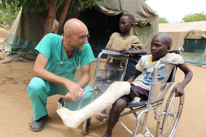 Dr. Tom Catena with a patient in Nuba Mountains. Humanitarian is being recognized for the second year in a row by being a finalist for the Aurora Award