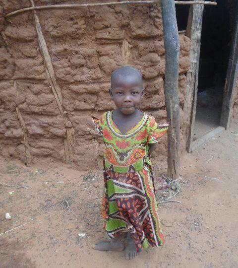 Wanzia Ngandi outside her home