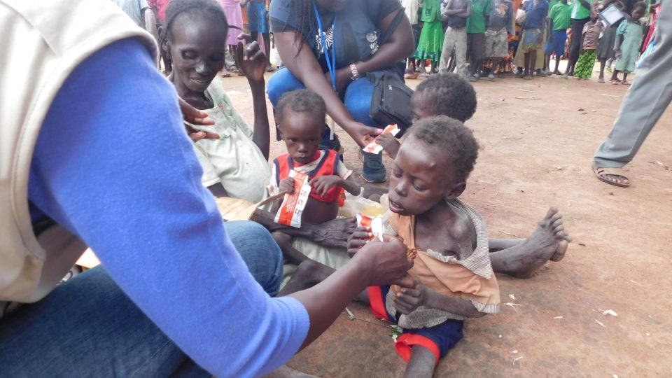 Child receiving care during a health and nutrition assesment in South Sudan
