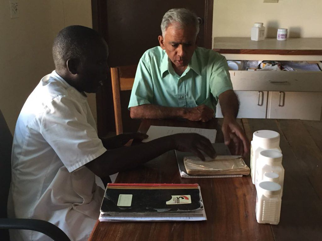 Dr. Rao working with Dr. Victor Mulengula, a psychiatric nurse. His story is as beautiful as it is heartbreaking. He joined the team on outreach to visit with patients