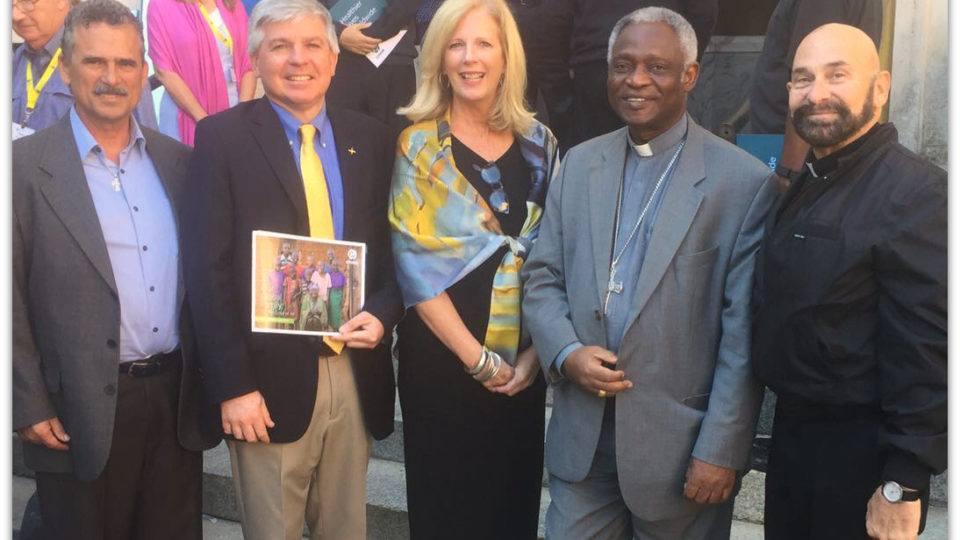 Feature Image Adrian Kerrigan, SVP Partnerships at CMMB with members of Cross International, Cardinal Turkson and Monsignor Tejeda