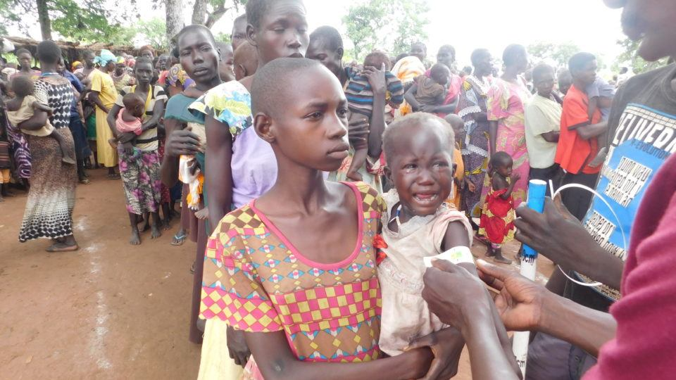 Internally displaced People awaiting for health assessments in Mvolo.