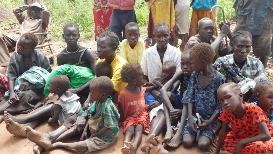 People waiting at a health and nutrition assessment in Mvolo. IDPs.
