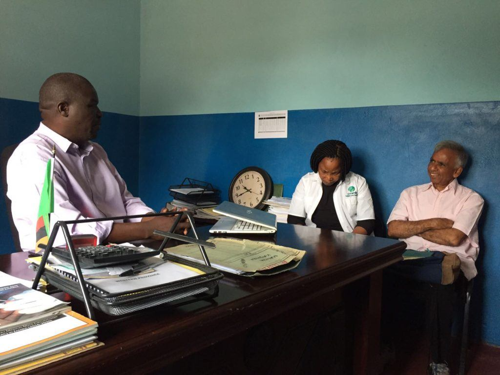 Dr. Tembo talks to Dr. Rao at the district office in Mwandi.