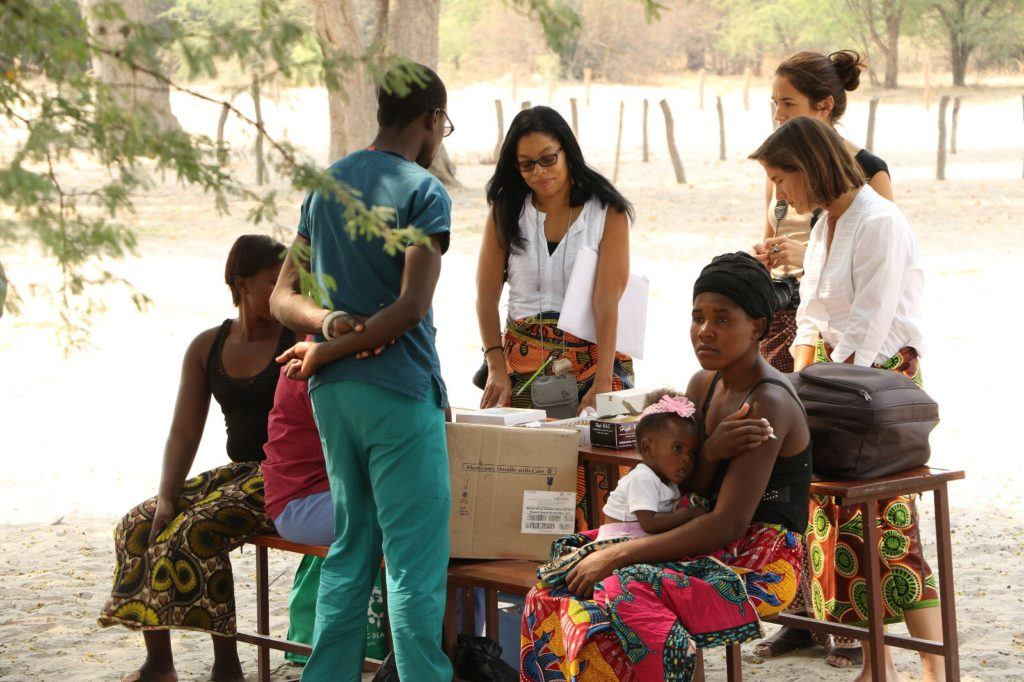 Dr. Danielle (center) speaks with nurses and community health workers.