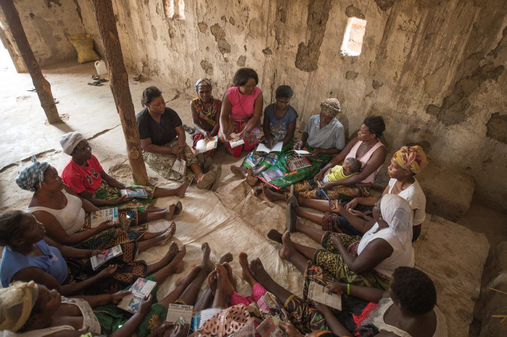 A symbol of catholic charity in action- picture of mothers sitting in a circle in Zambia