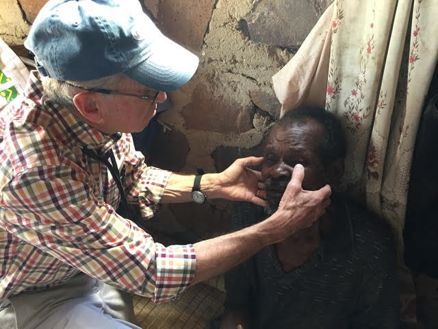 Dr. Al Hartmann examines a eSwatini (formerly Swaziland)patient suffering from advanced cancer.