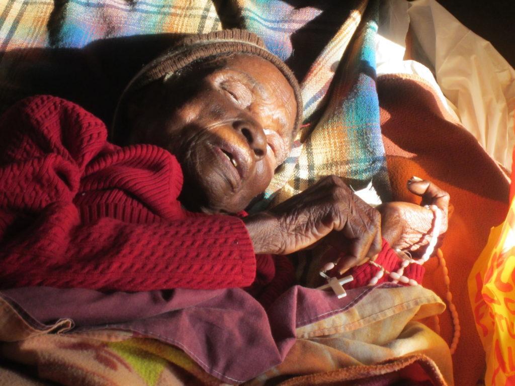 Gogo Lozika Swaziland grandmother with rosary.