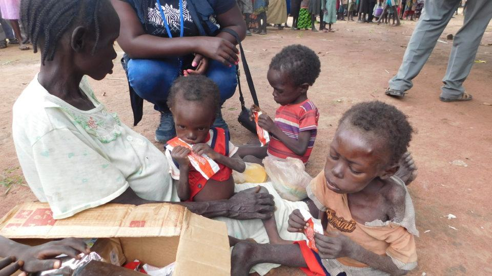 family in South Sudan receiving much needed food