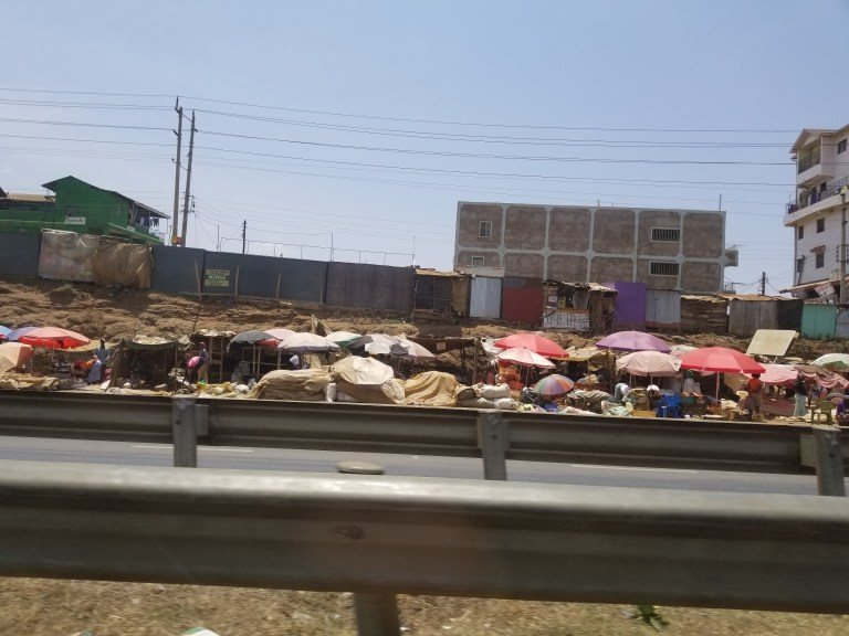 Images of the road side taken en route from Nairobi to Mutomo. People selling things close to the busy roads.
