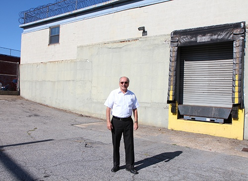 Ralph stands outside by the loading dock of CMMB's distribution center.