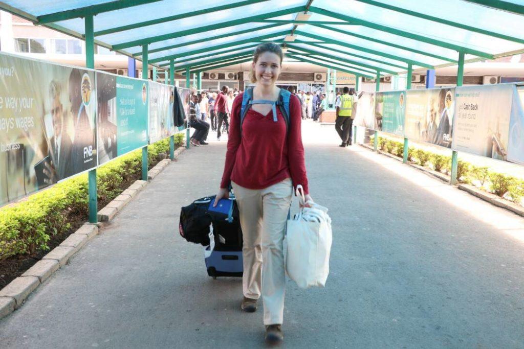 Rose arrives in Lusaka at international airport.