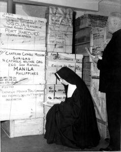 CMMB religious staff preparing shipments of medicine for disaster relief and emergency response activites in 1927