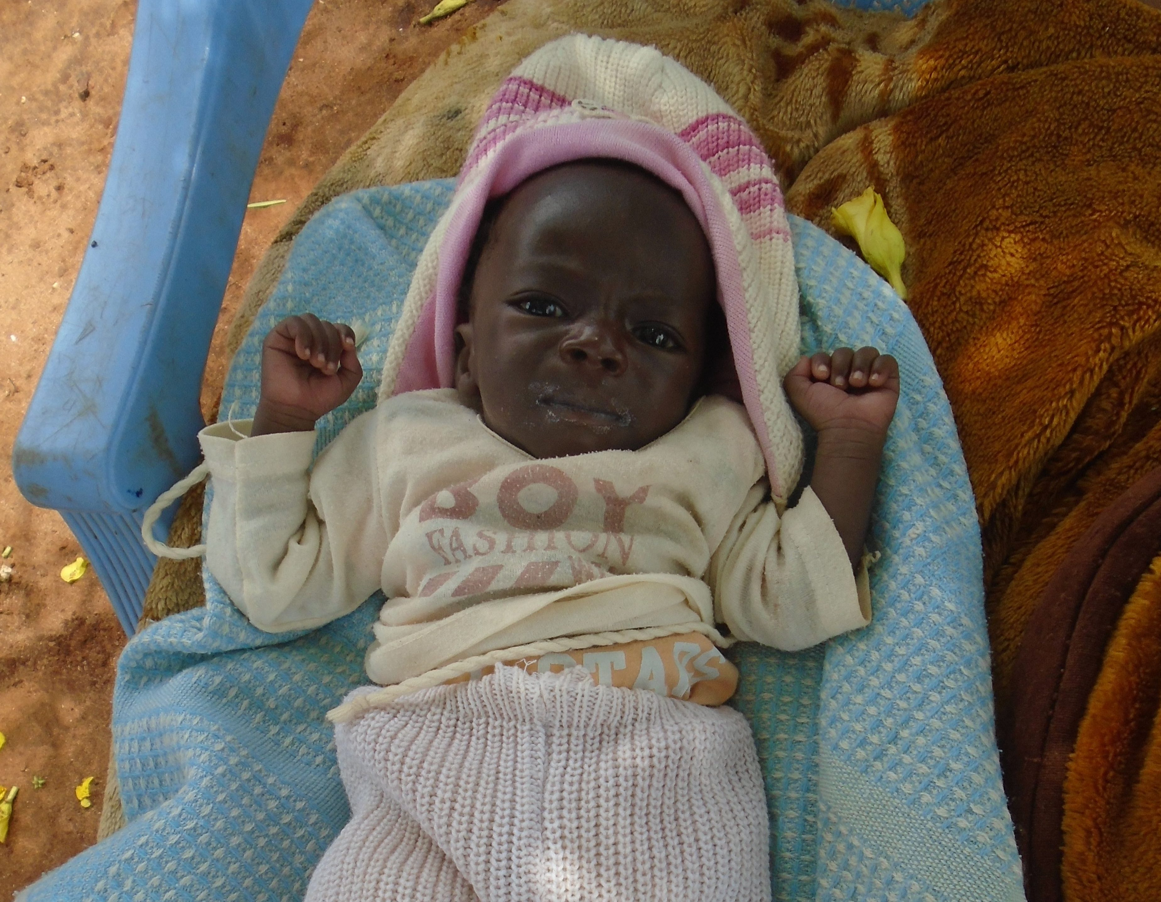Gedion, at one month old, was severely underweight and struggling to survive