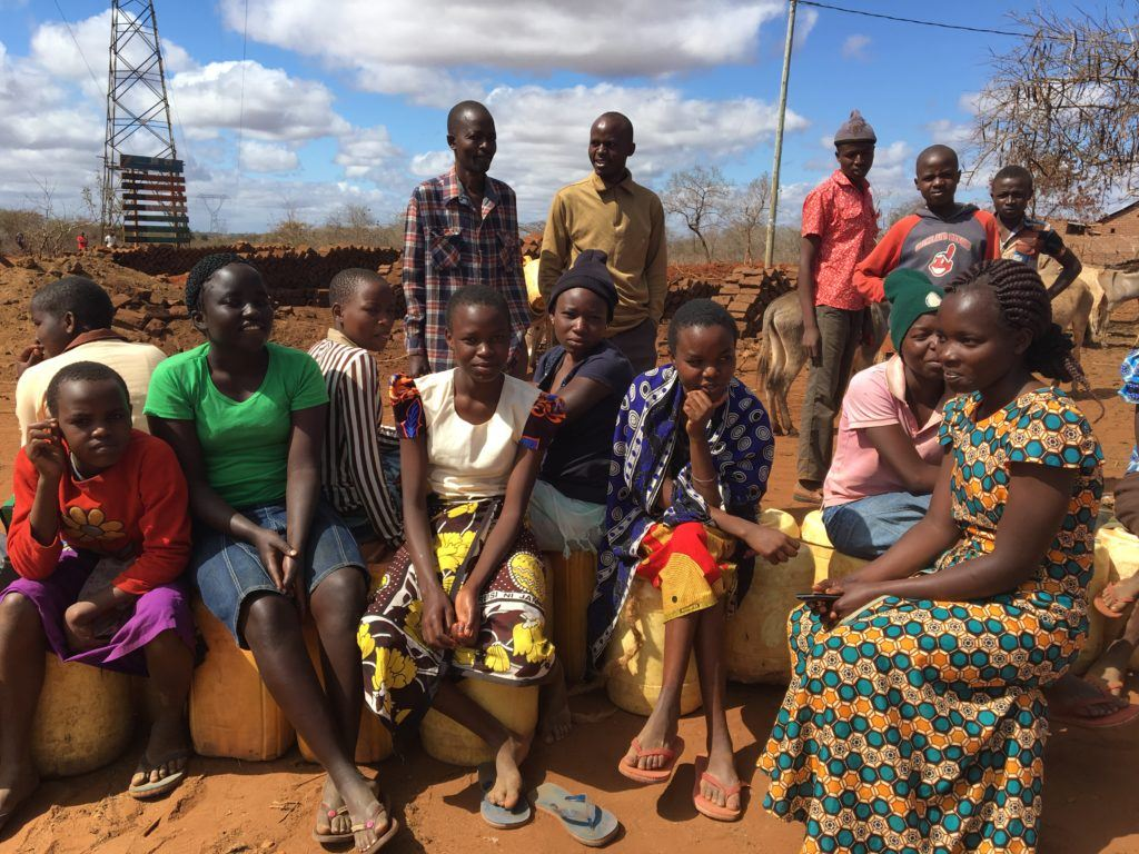 Cathryn takes photo of her team in Mutomo