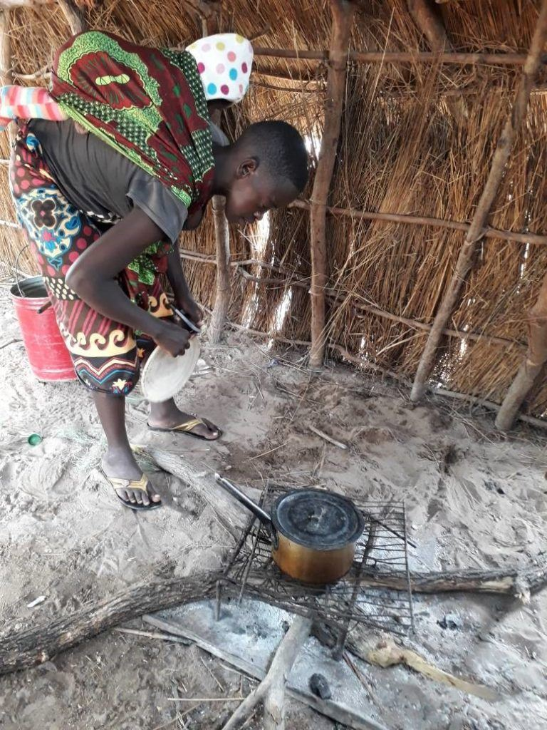 Fig: Mwaka prepares food for her children in their kitchen
