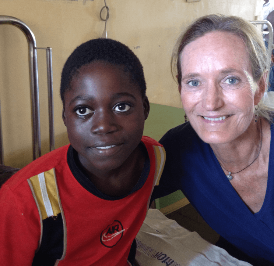 Mindy and a beneficiary child on a past trip