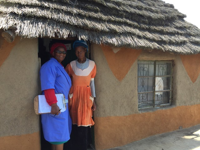 Sarah stands with a member of the Home-Based Care team in Swaziland. Sarah has cancer.