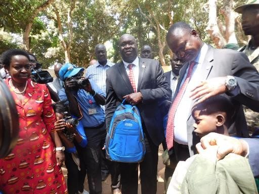 Vice President hands over reintegration kit to a child