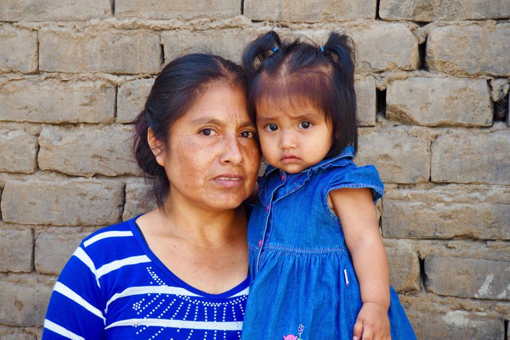 Beneficiary mother Marlene with her daughter Juanita, after receiving a confirmatory blood test that Juanita is no longer anemic.