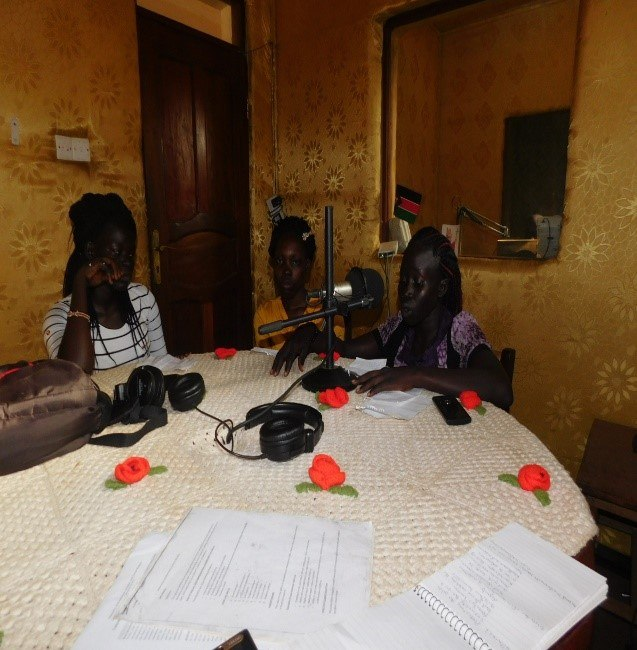Adolescent girls during a talk show session at the radio station