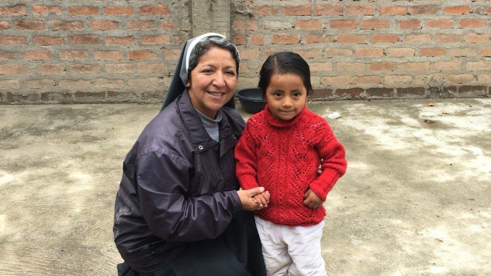 Sister Elena in Peru with a beneficiary.
