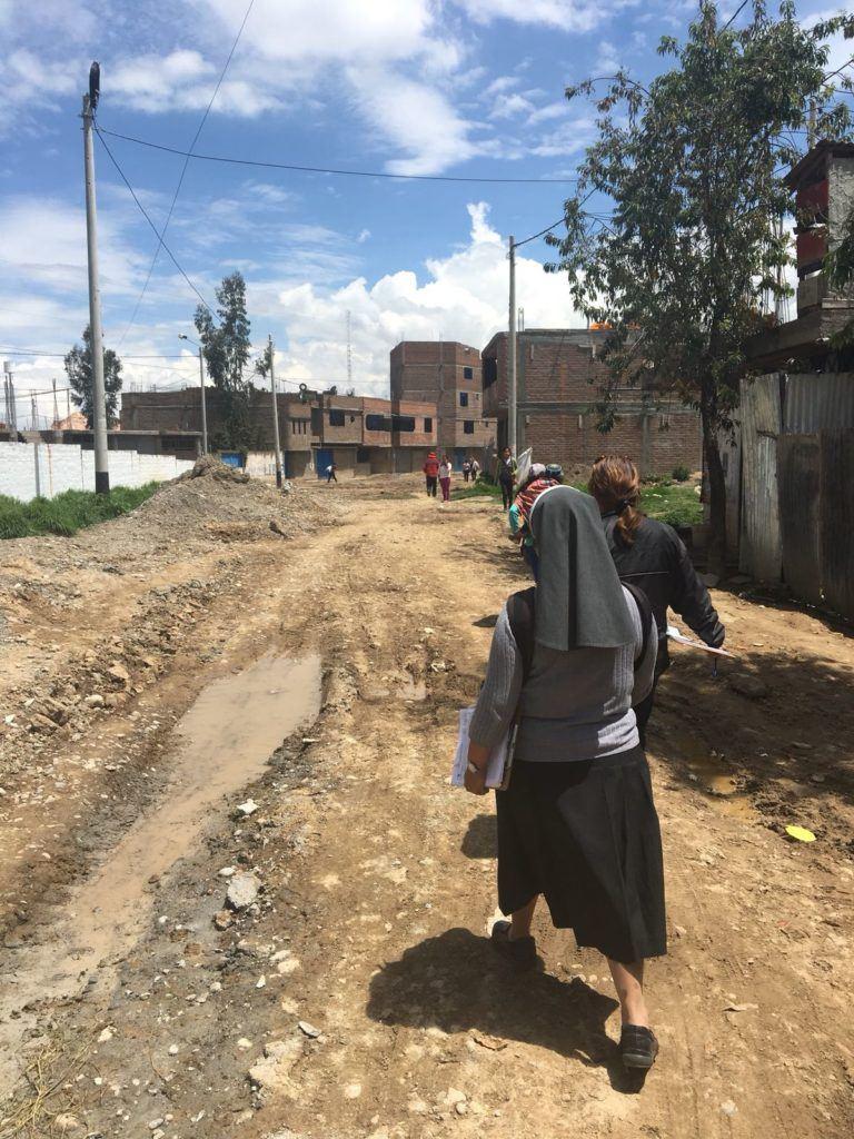 Walking in the community with Hermana Elena