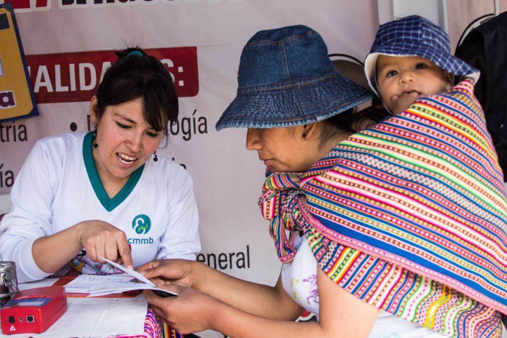 Mother, baby and nurse in Huancayo (Peru)