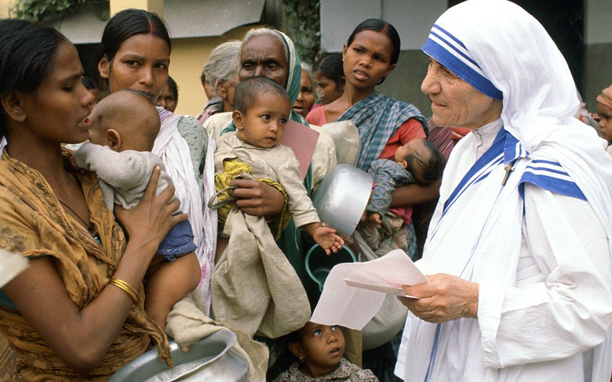 Mother Teresa working with the poor