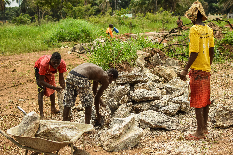 Workers Lifting Rocks at St. Theresa Hospital